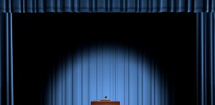 bigstock-A-podium-in-a-spot-light-on-st-14032844 - 1